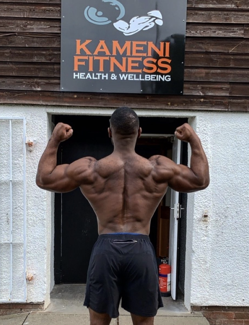Frank Kameni standing outside his gym